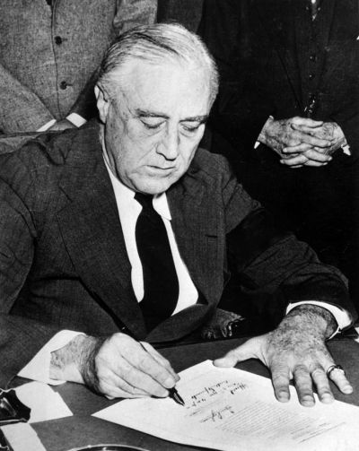 President Roosevelt signing the declaration of war against Japan, Dec. 11, 1941; Library of Congress.