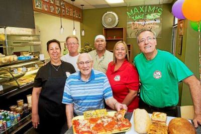 "<div class=""buttonTitle""><div class=""roundedlIcon white mbianco mprest""></div></div>Maxim's Food and Pizza Celebrates 70 Years"
