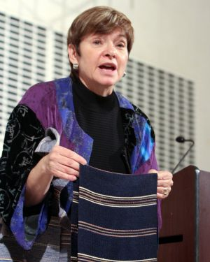 "Rabbi Barbara Aiello explains how hidden Jewish traditions are uncovered. Here she demonstrates how the woven ""vancale"" scarf from Tiriolo has its origins in the Jewish prayer shawl, called a ""tallit."""