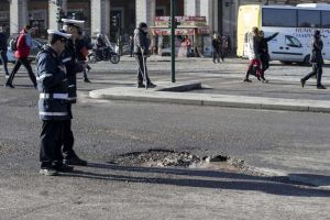 Locals in Rome have taken to the streets to cover the city's potholes with spray paint